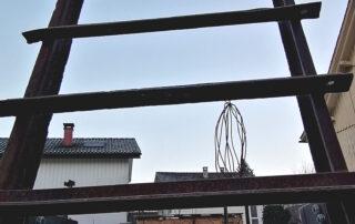 Straßenkunstwerk Leiter